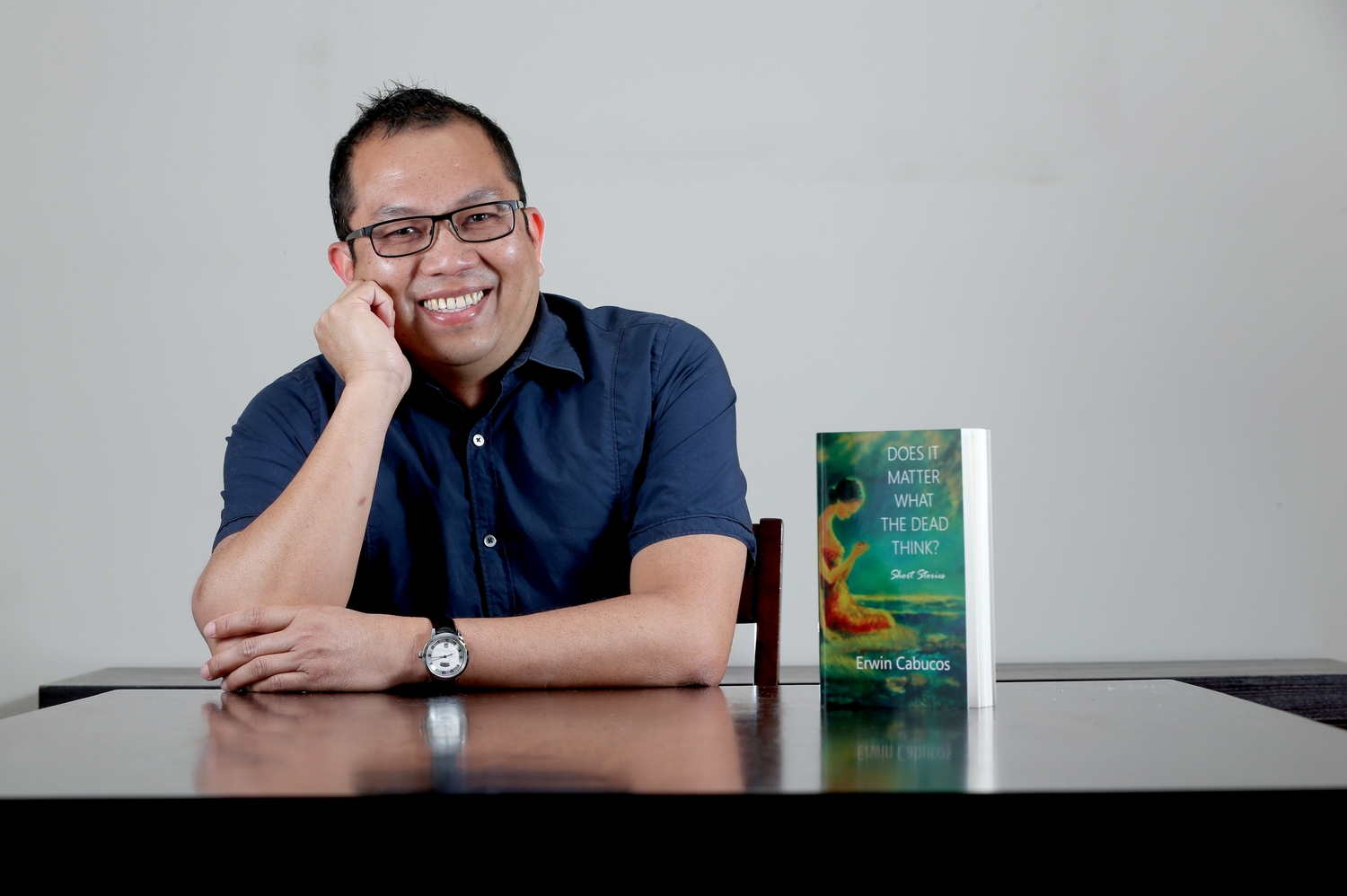 Author leaning on table